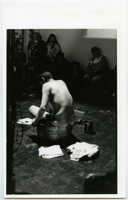 1992_09_12_Performance_Recreation_of_a_Dream_at_grunt_gallery_Zachery_Longboy_naked_in_galvanized_steel_tub