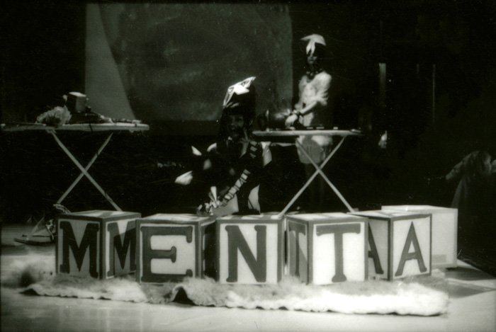 Sector_X_Victoria_Singh_2_masked_performers_blocks_in_front_spelling_MENTAL