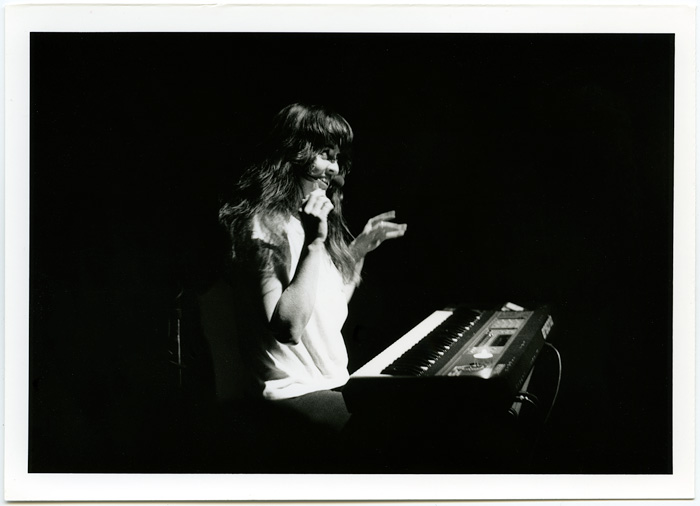 1991_09_13_Performance_untitled_Sandra_Lockwood_at_grunt_gallery_Lockwood_gesturing_behind_keyboard