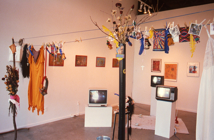 1998_01_30_Performance_Positive_Series_The_Stone_Show_slide_23_grunt_installation_three_TV_monitors_on_plinths_clothes_hanging_prints_on_wall_Zachery_Longboy