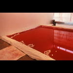 """Rubicon"" - installation view blood pool rubber boots"