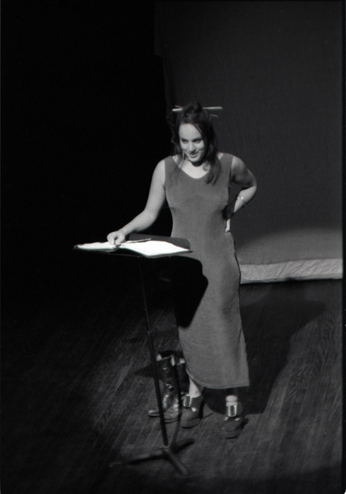 Too_Little_Too_Late_Too_Loaded_Christine_Taylor_leaning_on_music_stand_smiling
