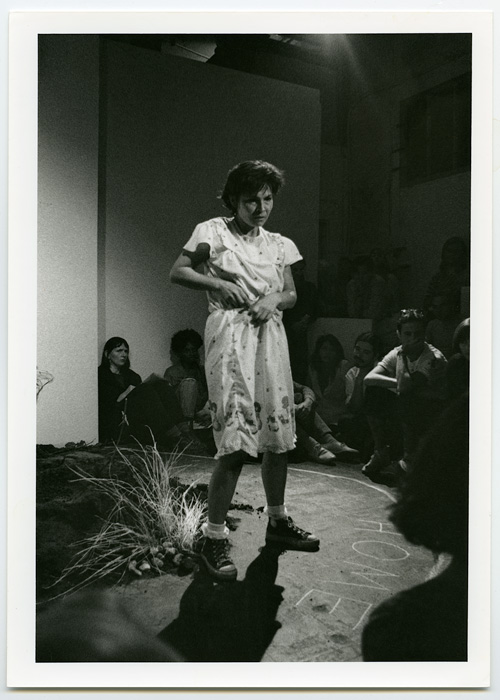 1990_09_10_Performance_Vancouver_Performance_Art_Series_untitled_Margo_Kane_at_grunt_gallery_Kane_standing_HOME_written_on_floor